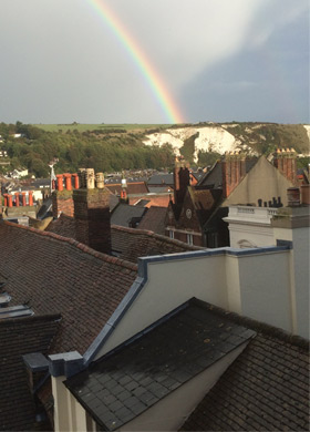 Rainbow over rooftops